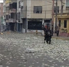 The streets of Venezuela are littered with worthless paper money.